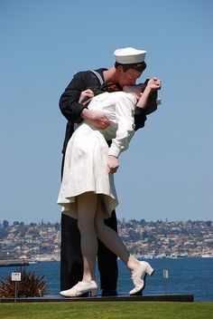 """Pause for a picture underneath the famous Unconditional Surrender (a.k.a. the """"kissing statue"""" sculpture located in the Port of San Diego."""