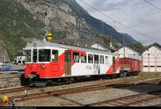 Electric cogwheel railcar BDeh 4/4 # 501 of the Martigny-Châtelard Railway (now TMR) with freight cars in Vernayaz. The railcar for 830 V DC from third rail or overhead wire was built in 1980 by SWP, SLM and SAAS and isn't in regular service nowadays.