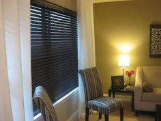 Faux wooden blinds, made from plain vinyl blinds and spray paint. Way cool.