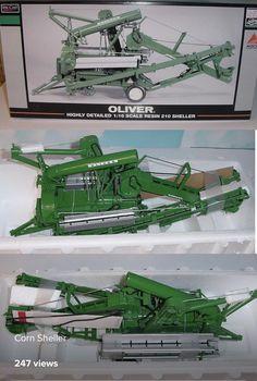 A toy Oliver corn sheller. Farmall Tractors, Old Tractors, Antique Tractors, Vintage Tractors, Tractor Photos, Naval History, Farm Toys, Old Farm, Brochures