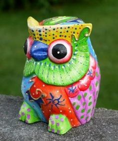 A colorful owl piggy bank from Balibarang-Shop!  I hope there's a way to get coins out of the bottom... way too cool to break!