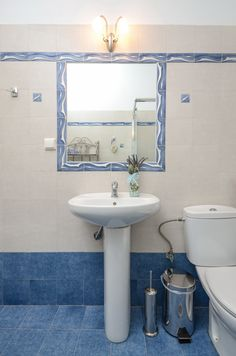 The bathroom of Villa of Roses that sparkles with purity with shower cabin. Shower Cabin, Living Room With Fireplace, Sitting Area, Beautiful Islands, Beautiful Gardens, Sparkles, Villa, Roses, Bathroom