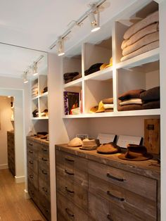 Track lights included in this closet make the space attractive and contents easier to see. Photo courtesy of Artistic Designs for Living