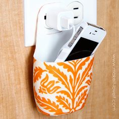 Holder for Charging Cell Phone (made from lotion bottle) crafty-stuff