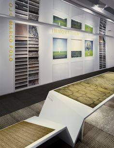 Before - Wall displays conveniently showcase Milliken floor covering collections.