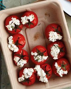 Stuffed Cherry Tomatoes | Martha Stewart Living - These red-and-white patriotic little bites are made ahead and bursting with flavor. As they are stuffed with goat cheese, don't leave them to sit out in the hottest spot on the buffet table; but we expect they'll be gobbled up so fast this won't be an issue.