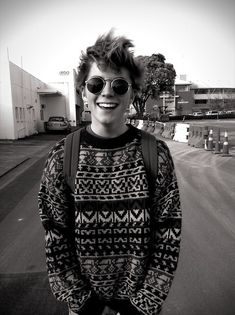 Conor- happy, carefree, crazy sweater- his trademark style and nature.