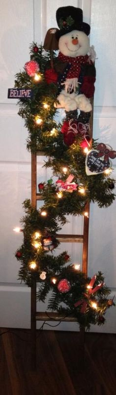 Christmas Ladder - My way of using the antique ladder my husband built for me that can no longer be used the way it was intended - this way I don't have to throw it out.