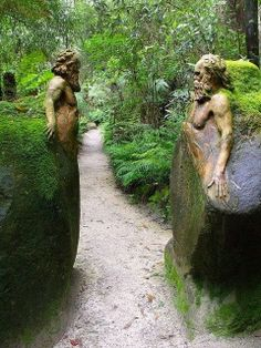 Incredible statues apparently carved from the stone of which they are a part. Guardians at the gateway ~ William Ricketts Sanctuary in the Dandenong National Park near Melbourne, Australia