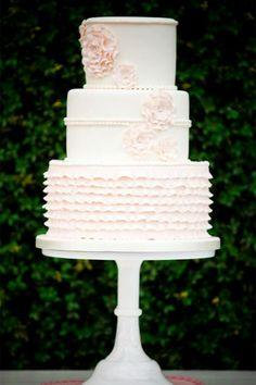 Classic white ruffled wedding cake. Photography courtesy of Badger Photography.
