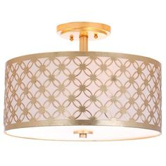 Known for its revolutionary fashion finds, a top London boutique founded in the 1970s inspired this modern retro-chic flush mount ceiling lamp. At the height of style, it elevates any space with its vintage pattern. Crafted in brass and finished in gold.