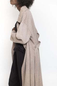 The Achro Wool Blend Coat in taupeis an oversized handmade coat with a self-tie belt at the waist featuring dropped shoulders, front side pockets and unline...