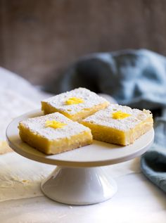 Classic lemon bars with a luscious lemon filling and a buttery shortbread crust. An easy bakery recipe for making lemon squares from scratch. Potluck Recipes, Bakery Recipes, Appetizer Recipes, Dessert Recipes, Fruit Dessert, Easter Recipes, Dessert Bars, Summer Recipes, Drink Recipes