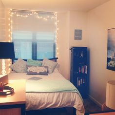 I love the way this room looks so simple and I'm in love with the fairy lights around the window!!!
