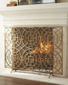 """Pyra"" Fireplace Screen at Horchow. A variety of geometric shapes combine to make this hand-wrought fire screen as decorative as it is functional. Decor, Fireplace Screens, Fireplace Accessories, Traditional Fireplace, Fireplace Makeover, Home Decor, Home Accents, Fireplace, Home Deco"