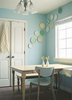 I want to do a plate wall in our next dining room! I only have one plate for it so far...I need to get on the ball. I also love how light & sunny this room is...
