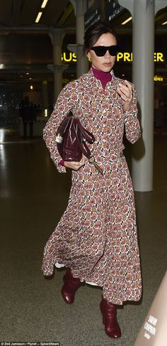 Wrapped up: Victoria Beckham, 43, has swapped her skin-flashing ensemble for a much-more demure look as she stepped out in London on Wednesday