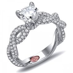DemarcoJewelry.com  Available in White Gold 18KT and Platinum. 1.31 RDCapture her grace and endless beauty with this confident yet elegant design. We have also incorporated a unique pink diamond with every single one of our rings, symbolizing that hidden, unspoken emotion and feeling one carries in their heart about their significant other. This is not just another ring, this is a heirloom piece of jewelry.   Demarco Bridal Engagement Ring.