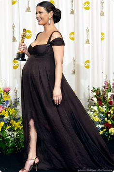 2003 Catherine Zeta-Jones was just entering her ninth month when she walked down the red carpet in a low-cut black gown with beaded straps and pink coral Fred Leighton earrings.  When she won for Best Supporting Actress (for Chicago),