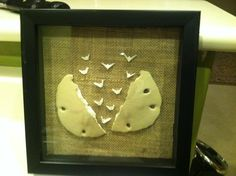 "broken sand dollar and ""dove like"" bones with burlap background made into bathroom decoration!"