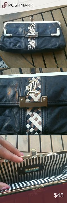 L.A.M.B 100% leather clutch L.A.M.B 100% leather clutch. Multi color woven detail at front and back. Inside reveals striped lining. Front flap pocket. Leather is super soft. L.A.M.B. Bags Clutches & Wristlets