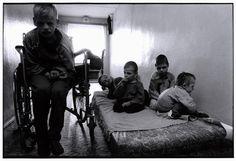 BELARUS. 1997. Novinki Asylum, Minsk. These boys spend each day huddled on a mat.    Paul Fusco/Magnum Photos