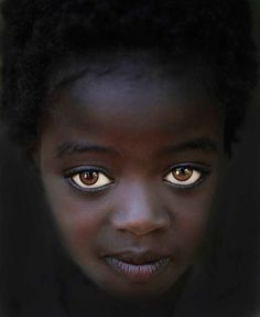 """STEVE WALLACE, 58, PHYSICIAN, YUMA, AZ ** """"Visiting the tribes in Ethiopia's Omo Valley, I stopped at the Omo Child Home (omochild.org) in Jinka. I noticed this beautiful girl with big eyes looking out from a dark hallway. As I started taking pictures of her, she followed me with her eyes as I took photos from several angles. We did not have a common language, so I gave her no instruction."""""""