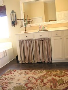 curtain to hide storage on bathroom vanity. we could even do this to our beds when we have storage underneath!