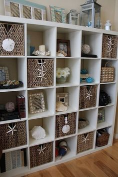 Decorating With Shells Storage bookcase bookshelf shelf shelving baskets starfish coastal beach house ocean sea decor accessories style accessorize #beachhousedecorcoastalstyle #coastalstyledecorating