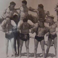 1950 men on beach muscular lean handsome shirtless on shoulders swim trunks speedo briefs cut square cut by Christian Montone, via Flick. Men Beach, Beach Bum, Boys Keep Swinging, 1950s Men, 1940s, The Last Summer, Le Male, Historical Images, Shirtless Men