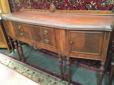NORTHERN FURNITURE COMPANY SIDEBOARD BUFFET WITH A BEAUTIFUL INLAY VENEER, CARVED AND TAPERED LEGS, BEVELED EDGE TOP AND MEDALLION AND RIBBON RAISED BACK. THE TOP CENTER DRAWER IS LINED IN FELT AND CONTAINS NUMEROUS COMPARTMENTS ALONG WITH A REMOVABLE SILVERWARE TRAY. MEASURES 45 INCHES HIGH BY 79 INCHES LONG BY 22 INCHES DEEP. SOME NICKS AND SCRATCHES PRESENT BUT AN OVERALL SOLID PIECE. PLEASE SEE LOT 12009 FOR A MATCHING DINING TABLE AND CHAIR SET