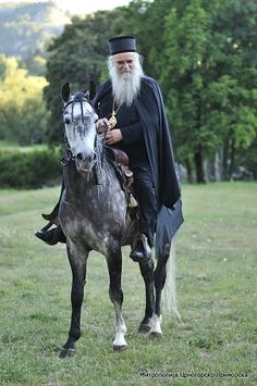 His Eminence Metropolitan of Montenegro and the Littoral , Amphilochius ~ riding a horse.