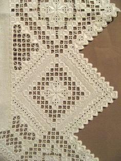 Hardanger Embroidery -   Hardanger is a form of embroidery which developed in Hardanger, Norway. It features cutwork and satin stitch arranged intricate, geometric designs.