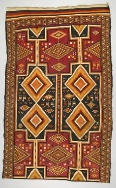 Africa | Rug from Redeyef, Tunisia | ca. 1940 - 50 | Wool; interlocking tapestry woven, supplementary weft.