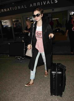 Model and actress Lily Collins traveling with her RIMOWA at LAX Airport.