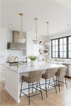 Beautiful white kitchen pendant lighting ideas you'll love - modern coastal kitchen decor with beautiful brass and white pendant lighting over the island and woven counter stools - Christine Andrew - Home Decor Kitchen, Interior Design Kitchen, New Kitchen, Kitchen Ideas, Family Kitchen, Rustic Kitchen, White Coastal Kitchen, Small Kitchen Redo, Kitchen Dining Living