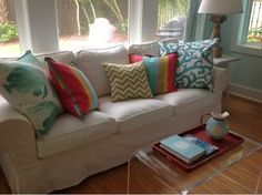 The Power of Pillows. Love the slipcover.