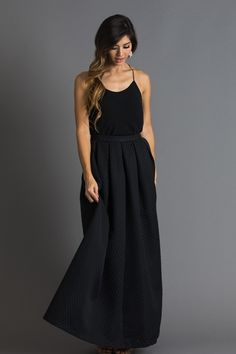 Maxi skirts are a great alternative to a gown for a holiday party or gala, because you'll be able to wear them more than once! This thick black polka dot maxi skirt is so versatile and so fun to style