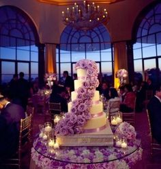 Cake with purple roses. Absolutely love this cake and the setup.