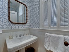 I cannot wait until I can wallpaper a powder room, and the bamboo mirror aint so bad either.