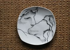 Hand-painted porcelain plate.