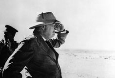 """""""During his stay in the Middle East, Britain's Prime Minister Winston Churchill paid a visit to the Alamein area, meeting brigade and divisional commanders, visiting a gun site, and inspecting personnel of Australian and South African divisions, on August 19, 1942 in the western desert."""" (AP)"""