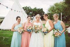 Naomi Neoh Marie Wedding Dress   Mis-Match Pastel Bridesmaids   Odo's Barn Kent   The Bell Tent Company   Outdoor Reception   Lemonade Pictures   http://www.rockmywedding.co.uk/hayley-jon/