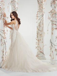 Sophia Tolli - Y11403 – Brienne -Lace a-line wedding dress with v neck, stunning lace with pearl detailing signifies this chic slim A-line gown with front and back deep V-necklines. Brienne also offers lace and sheer tulle shoulder straps and a sparkling crystal brooch at the empire waist. A modern fairytale detachable chapel length train trimmed with matching scalloped lace accentuates the revealing sheer tulle and lace back bodice finished with a concealed back zipper and diamante…
