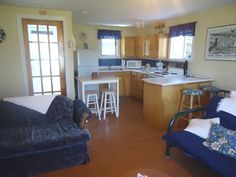 Housekeeping cottage for rent in Rocky Harbour, Gros Morne National Park, Newfoundland. Overlooking the water and Gros Morne Mountain. Gros Morne, Newfoundland, Cottages, Corner Desk, National Parks, Furniture, Home Decor, Homemade Home Decor, Cabins