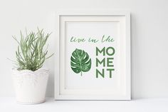 Live In The Moment - a modern motivational quote art print created with a combination of watercolor brush calligraphy and a bold block font.