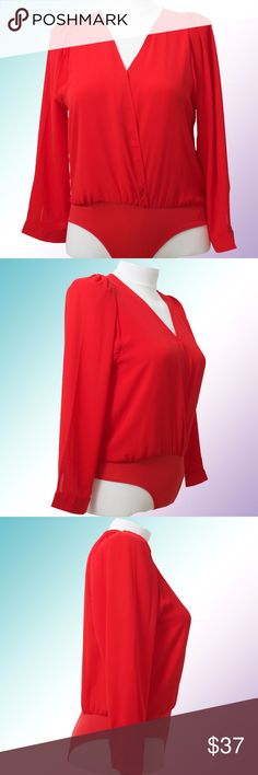 Plus size Red Wrap Front Blouse/Bodysuit Red wrap front blouse/bodysuit so you'll always stay tucked in. Long sleeves have a button at the wrist and bodysuit has snap buttons below. Lightweight and goes perfectly under our blazers! This one does not have a defect but we're still selling at the discounted price! Available in sizes 1x, 2x, 3z and off white. Shop The Aivy's Closet for young, professional, fashionable and affordable attire! Tops Blouses