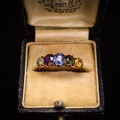 A beautiful combination of colours in this multi-gem (harlequin) 5-stone ring. It dates to the late Victorian era, circa 1890, home to a light blue sapphire, peridot, cirtrine, amethyst, and tourmaline.