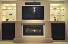 Modern entertainment center with fireplace modern entertainment entertainment centers with fireplaces entertainment center with natural gas Basement Fireplace, Home Fireplace, Fireplace Remodel, Modern Fireplace, Living Room With Fireplace, Fireplace Design, Fireplaces, Fireplace Ideas, Gray Basement