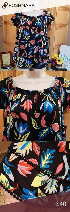 """Max Jeans of shoulder pom pom top,  NWT Max Jeans of shoulder pom pom top,  NWT, small but oversize fit to large  Colors are: black, red, pink, blue, gray,  yellow (flowers & leaves)  Measures flat: bust 19"""", length 22"""" on curved hem  Can be worn of shoulder or not.   NWT $40  Offers & bundle offers welcome Max Jeans Tops Blouses"""